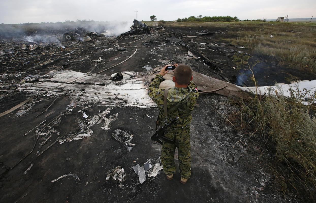 تصاویر + عکس سقوط هواپیمای مالزیایی در اوکراین