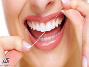 زمان مناسب برای استفاده از نخ دندان و نحوه صحیح نخ دندان کشیدن