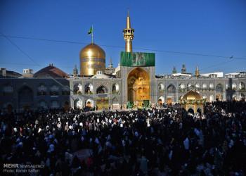 تصاویر آیین تعویض پرچم گنبد امام رضا (ع)
